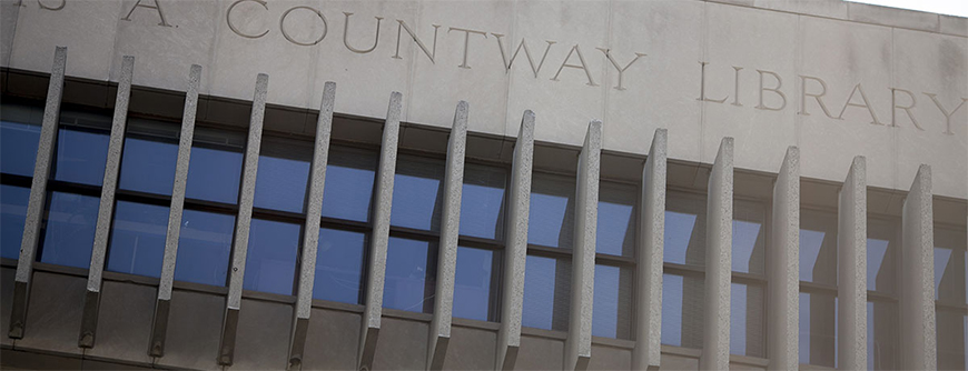 "Photo of the roof line of the Countway Library of Medicine with the words ""Countway Library"" carved into the stone"